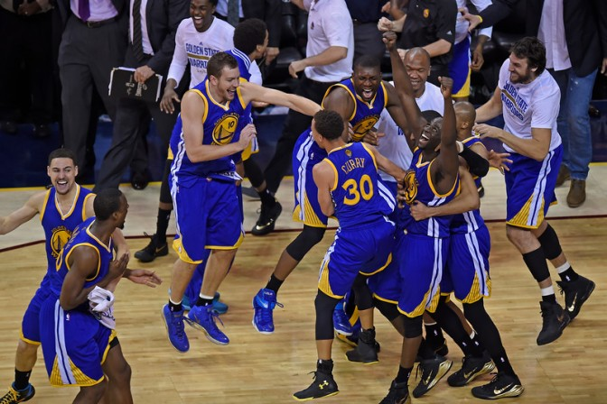 """The Golden State Warriors celebrate after winning the NBA Championship after defeating the Cleveland Cavaliers in Game 6 of the NBA Finals at Quicken Loans Arena in Cleveland, Ohio, on Tuesday, June 16, 2015. Golden State defeated Cleveland 105-97. (Jose Carlos Fajardo/Bay Area News Group)"""