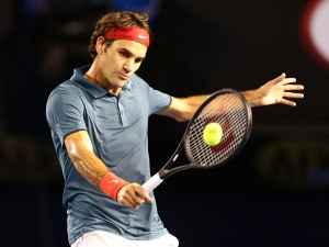 MELBOURNE, AUSTRALIA - JANUARY 20:  Roger Federer of Switzerland plays a backhand in his fourth round match against Jo-Wilfried Tsonga of France during day eight of the 2014 Australian Open at Melbourne Park on January 20, 2014 in Melbourne, Australia.  (Photo by Matt King/Getty Images)